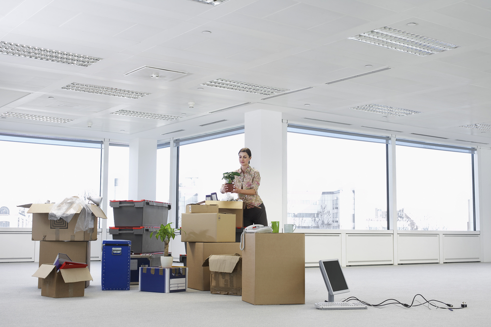 Office Relocation - Woman with Cardboard boxes